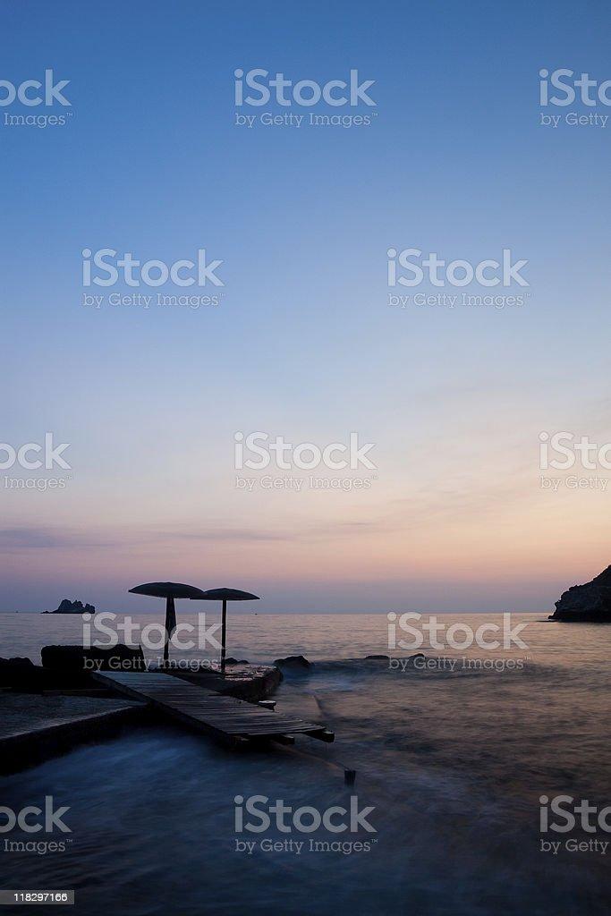 Corfu beach at sunset stock photo