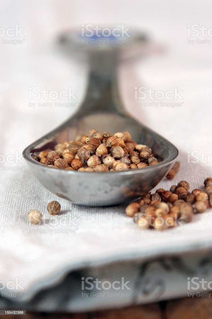 Coriander seeds in a spoon royalty-free stock photo