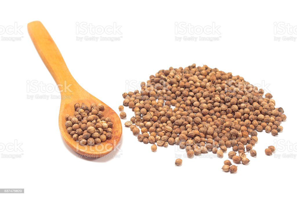 Coriander seeds with spoon isolated on white stock photo