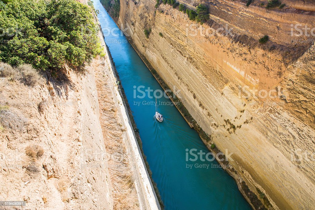 Corinth Canal,Greece...small sailing boat passing through stock photo