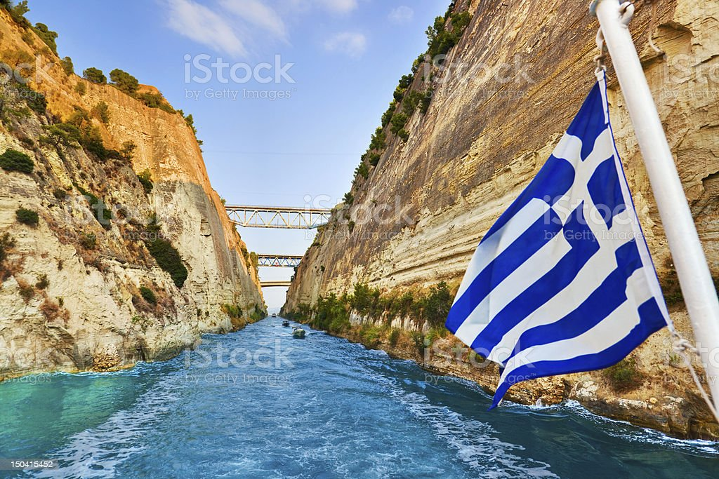 Corinth channel in Greece and greek flag on ship stock photo