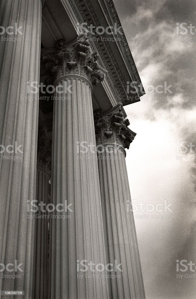 Corinthian Building Columns with Dramatic Sky, Black and White stock photo