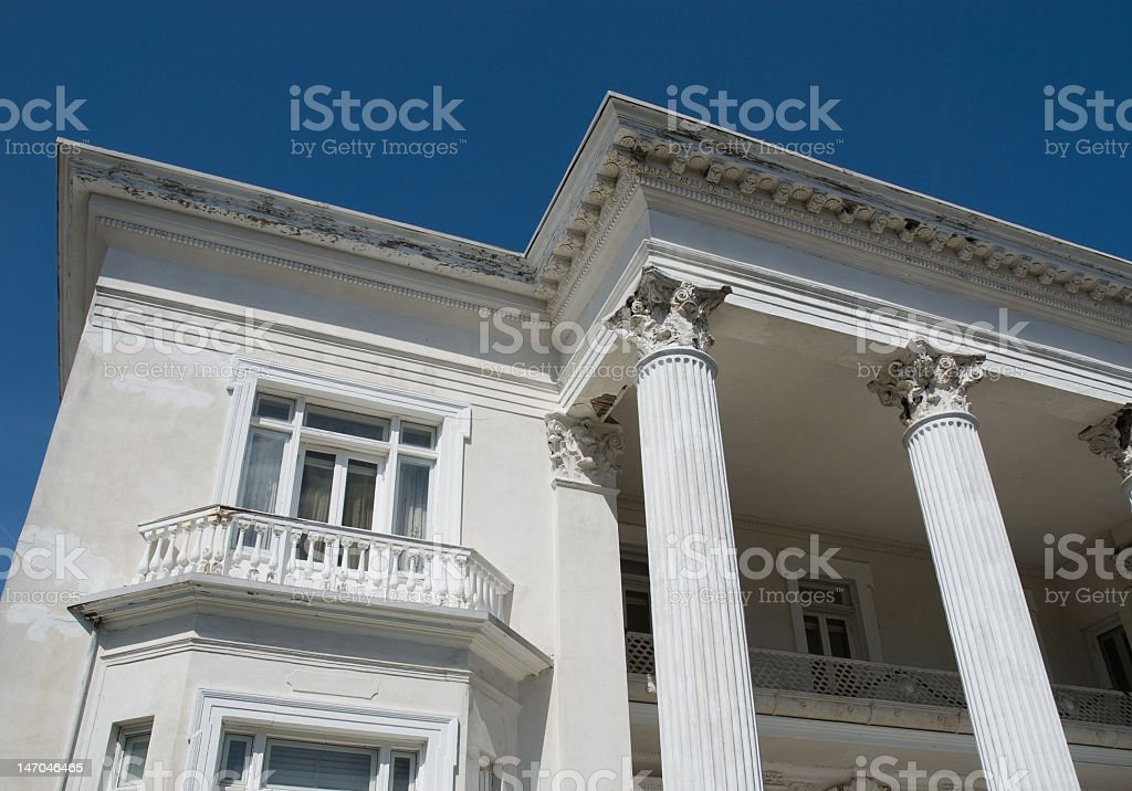Corinthian Columns on a White Mansion royalty-free stock photo