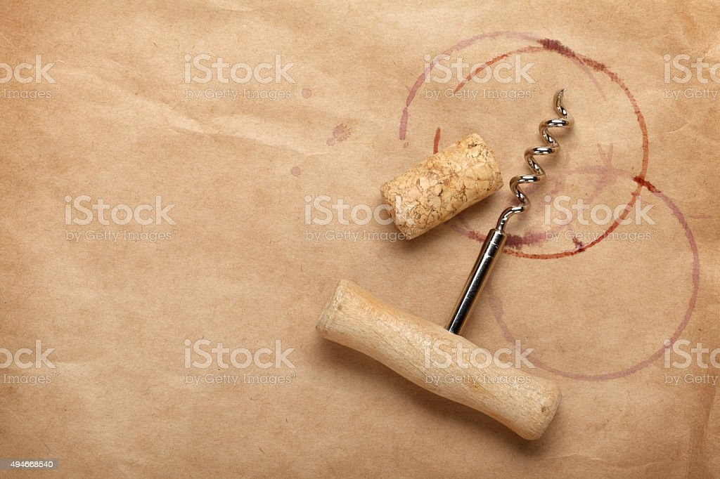 Cork and corkscrew with red wine stains stock photo