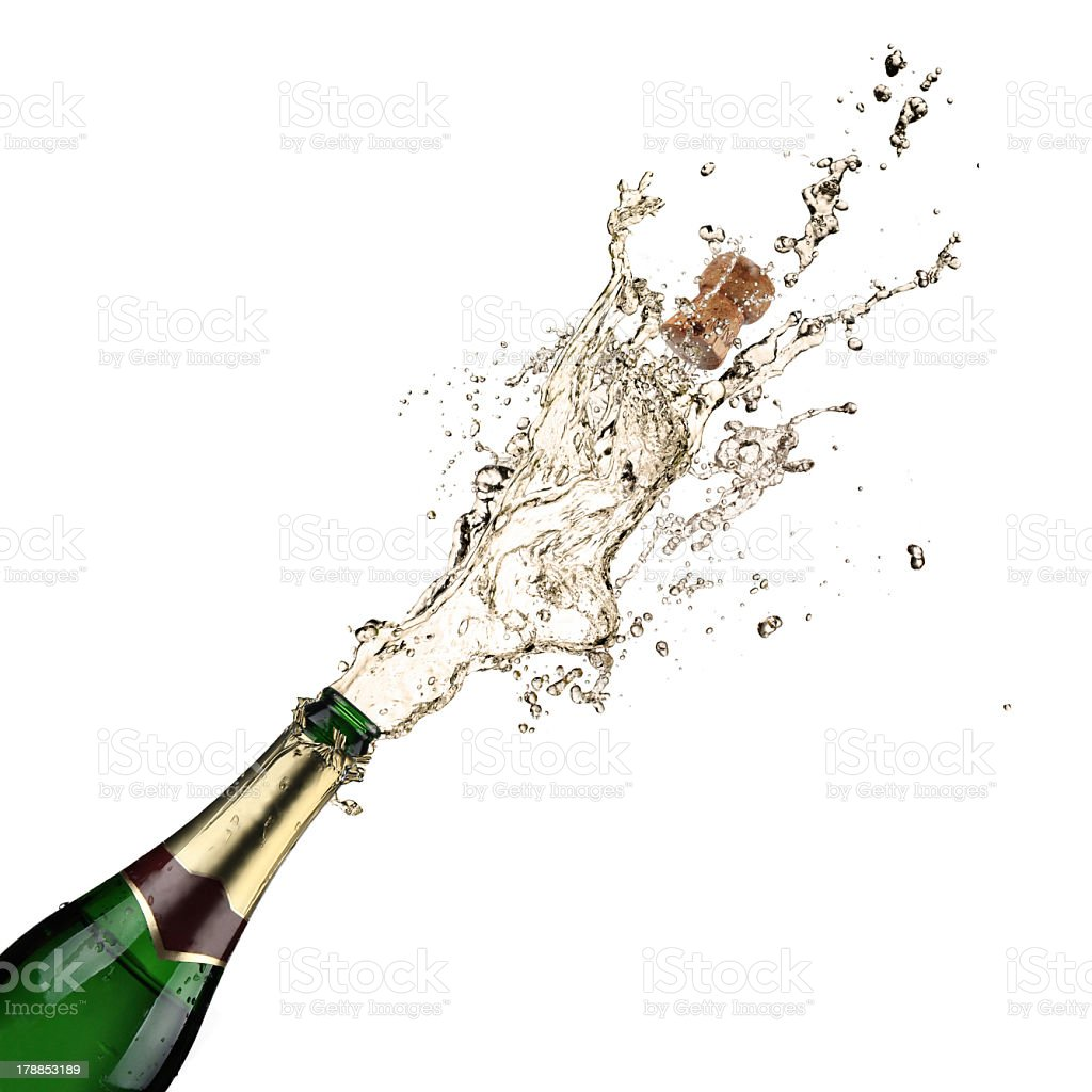 A cork being popped on a champagne bottle stock photo