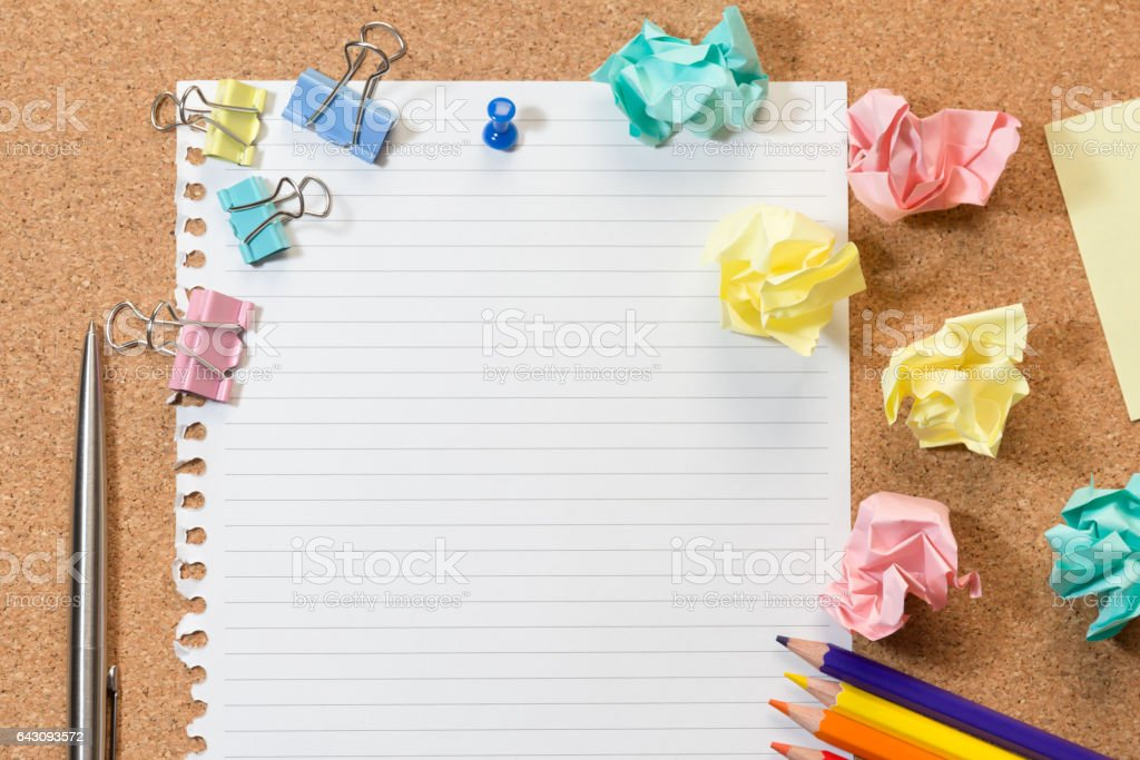 Cork board with blank paper and stationary stock photo