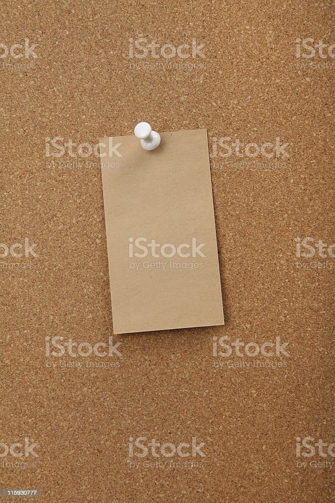 Cork board with blank paper royalty-free stock photo