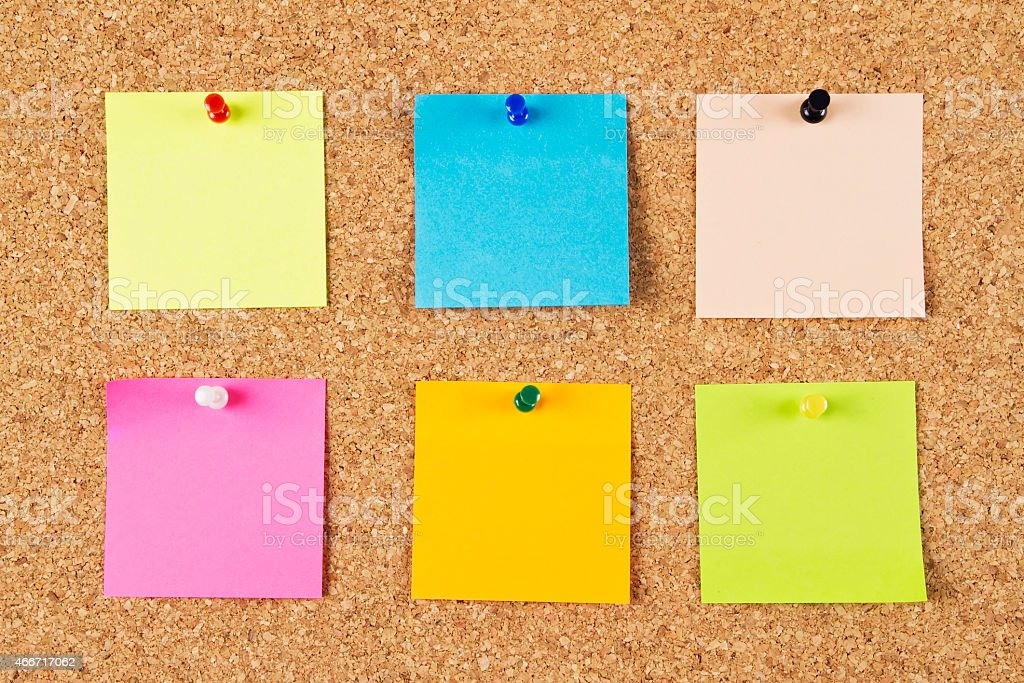 Cork Board with Colored Notepapers stock photo