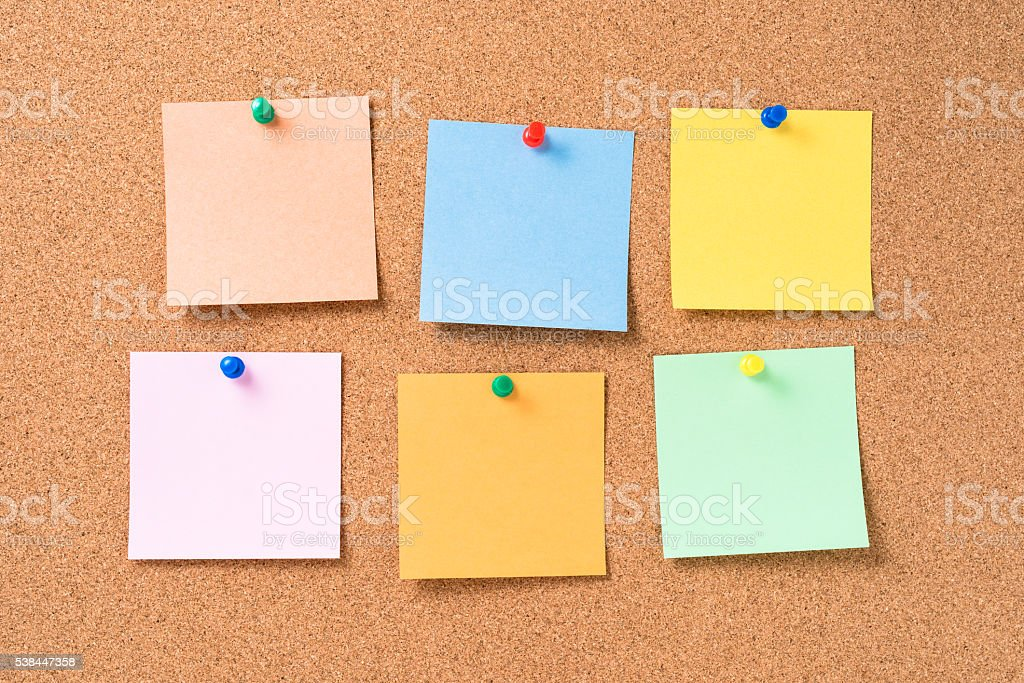 Cork board with colorful blank notes stock photo