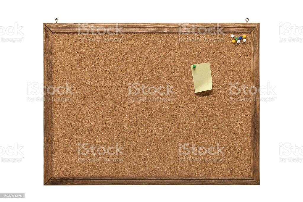 cork board with empty post-it note and pushpins stock photo