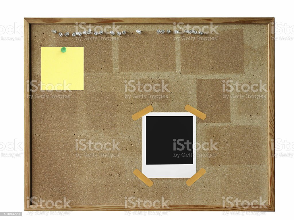 cork board with photo frame stock photo