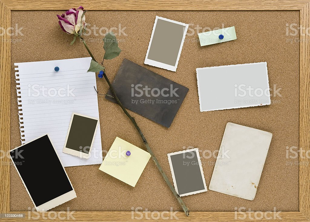 Cork Board with Pinned Blank Notes stock photo