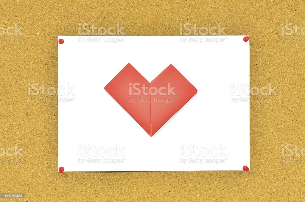 cork board with red heart on paper royalty-free stock photo