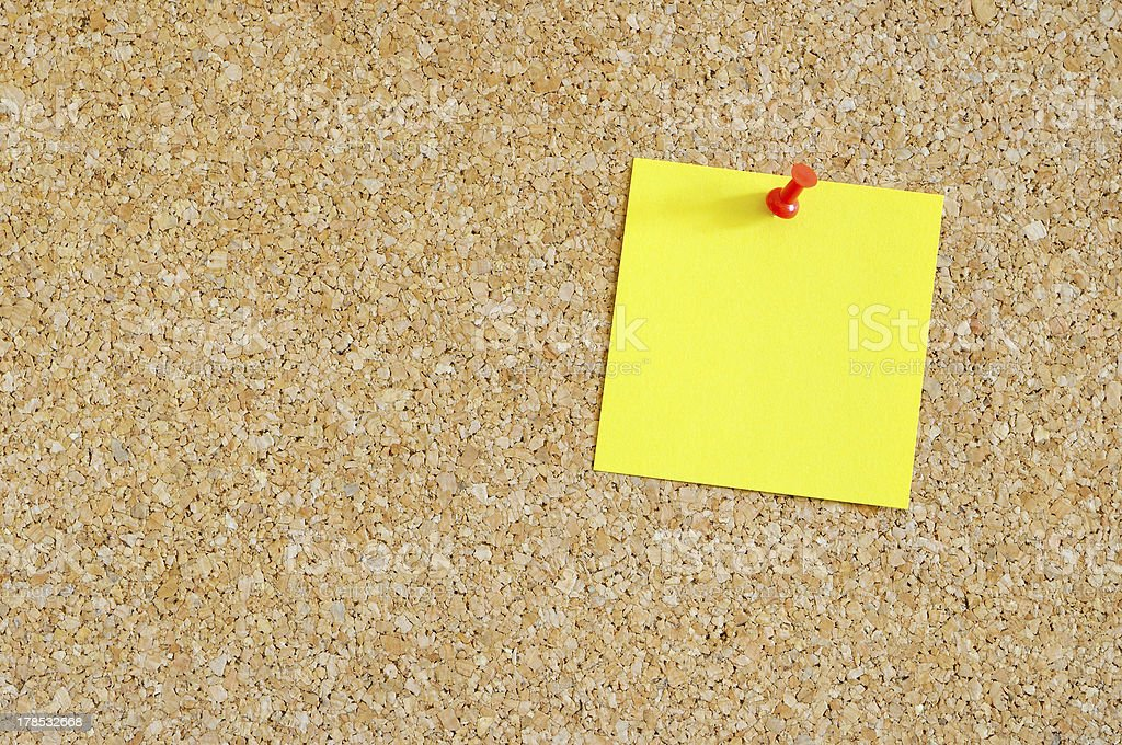 Cork board with yellow post-it royalty-free stock photo