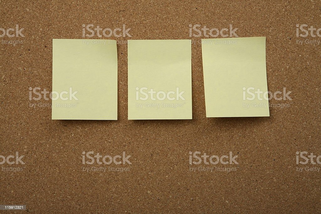 Cork board with yellow sticky note royalty-free stock photo