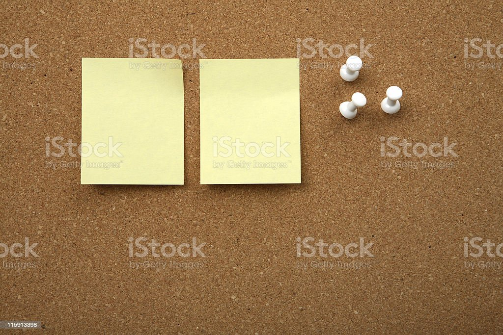 Cork board with yellow sticky note stock photo