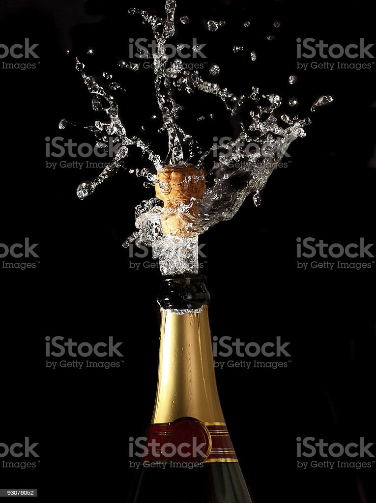 Cork exploding out of a champagne bottle stock photo