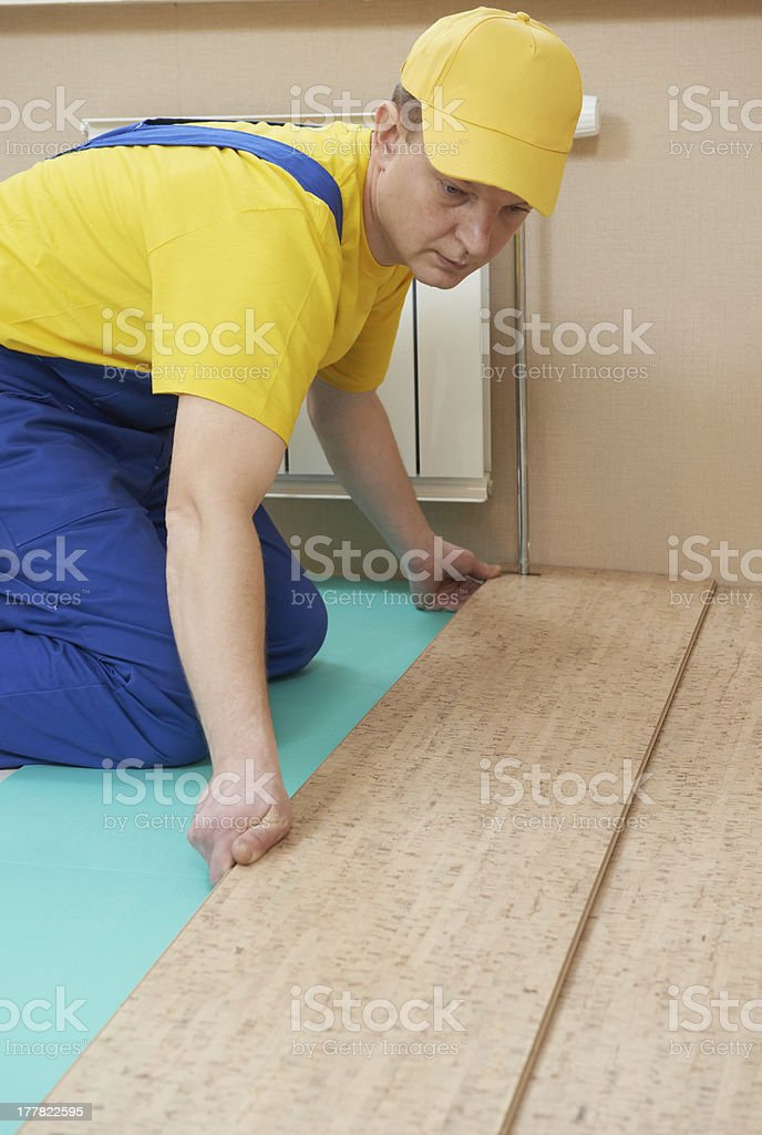 cork worker at flooring work royalty-free stock photo