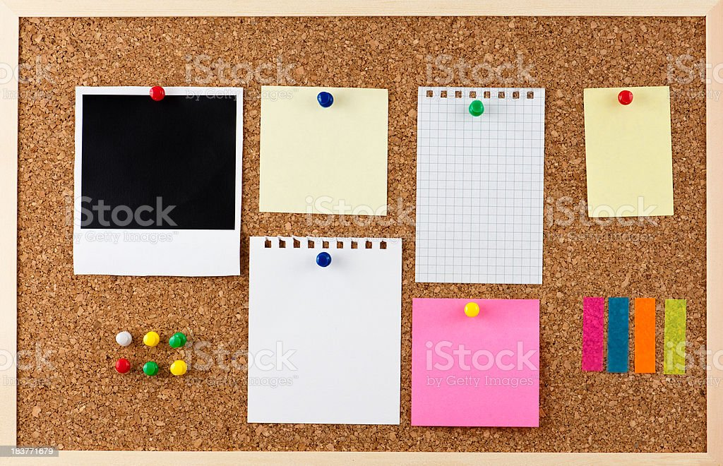 Corkboard and note papers stock photo