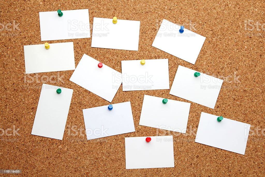 Corkboard with blank business cards royalty-free stock photo