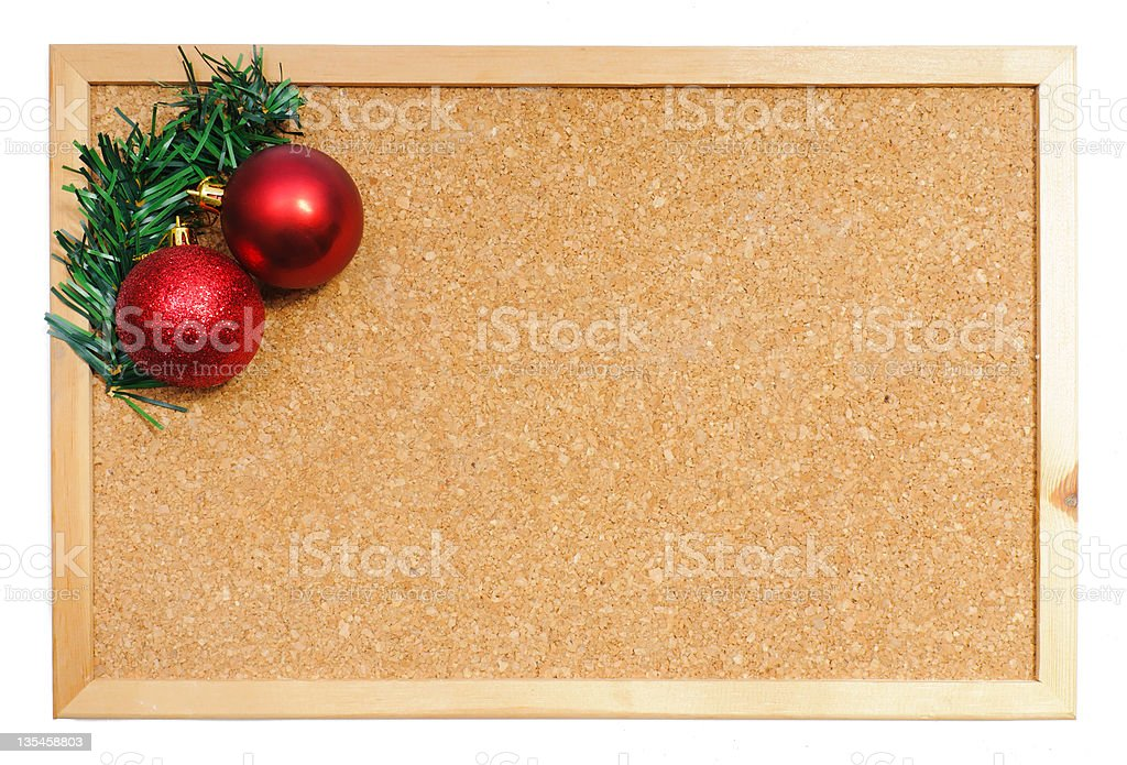 Corkboard with Christmas ornaments stock photo