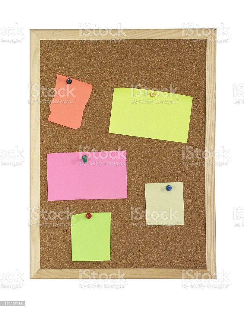 Corkboard with colorful notes and pins, isolated royalty-free stock photo