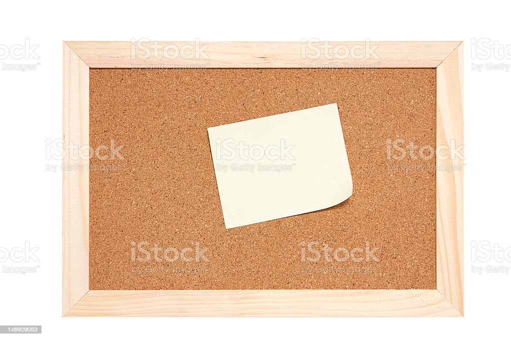 Corkboard with empty yellow notes royalty-free stock photo