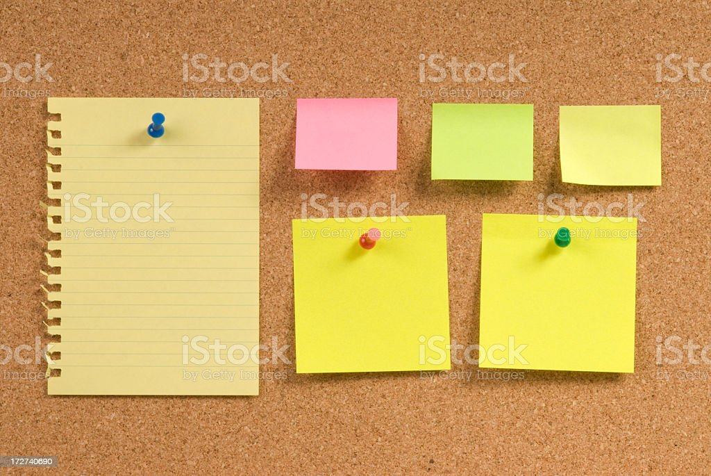 Corkboard with Notepapers royalty-free stock photo