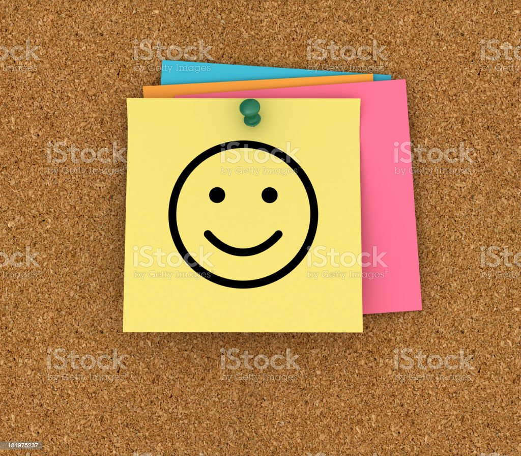 Corkboard with Sticky Notes and Smiley Face stock photo