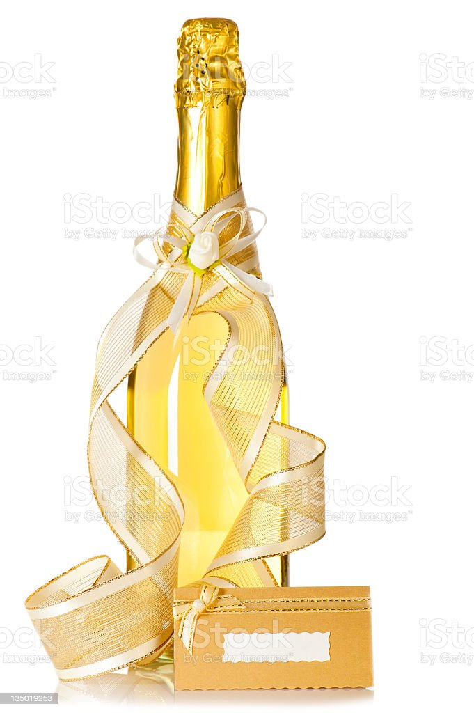 Corked bottle of champagne with wedding decoration royalty-free stock photo