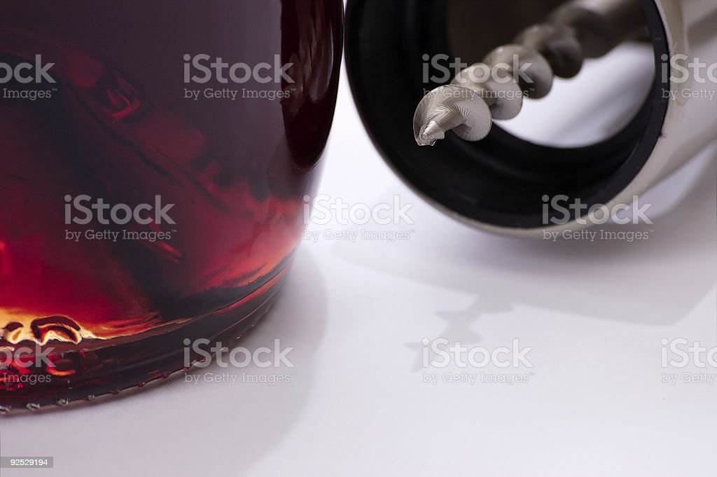 Corkscrew and bottle of red wine royalty-free stock photo