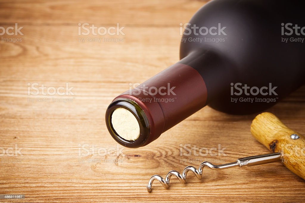 corkscrew and bottle of wine on the board stock photo