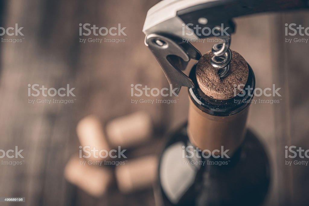 Corkscrew and bottle of wine stock photo