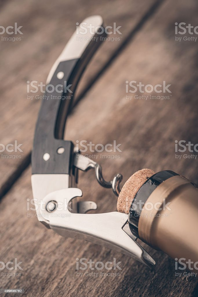Corkscrew and bottle of wine stock photo