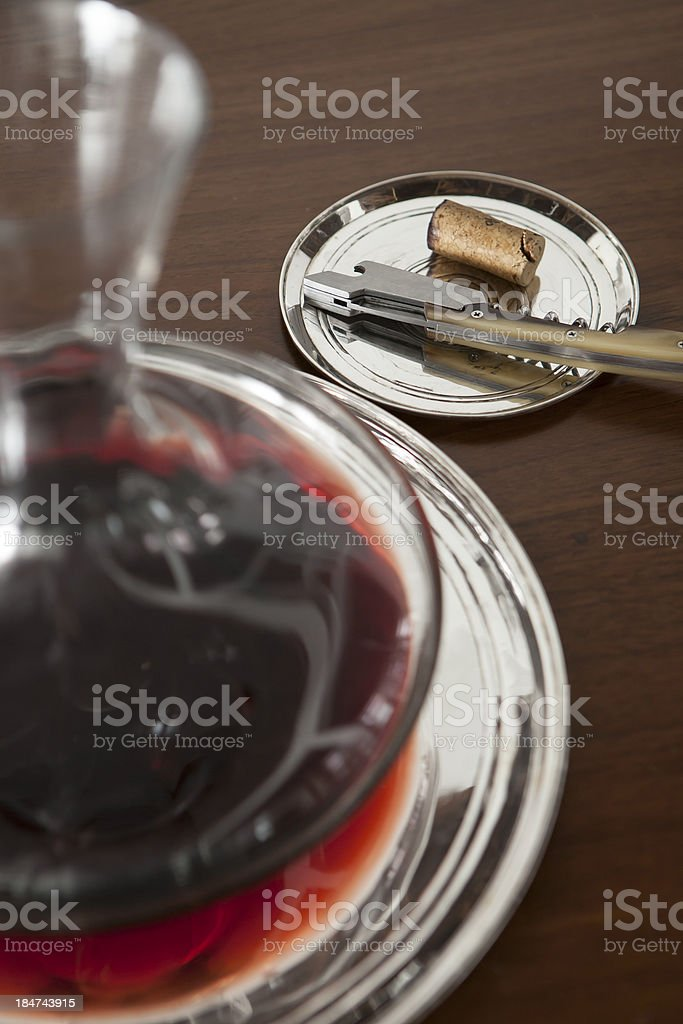 Corkscrew and red wine in decanter royalty-free stock photo