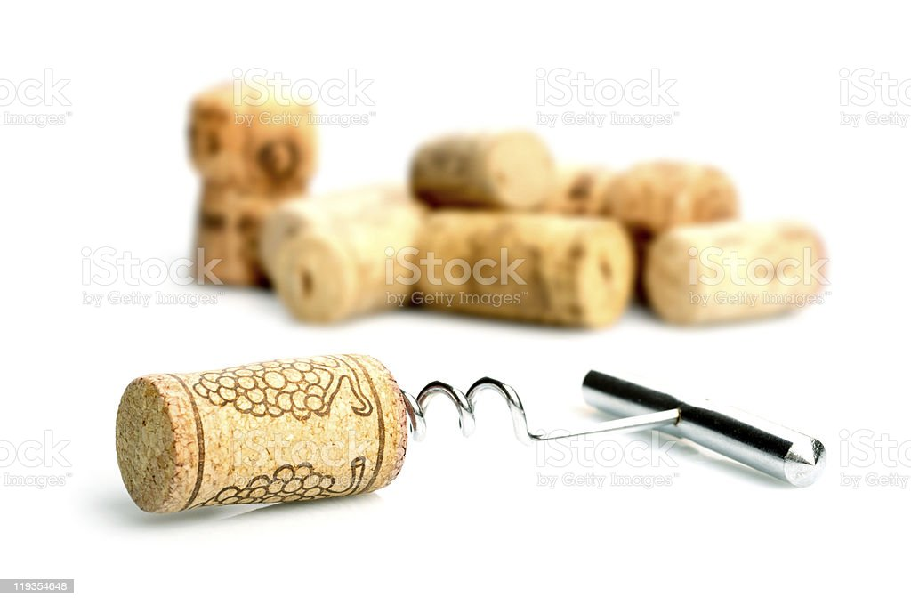 Corkscrew and wine corks stock photo