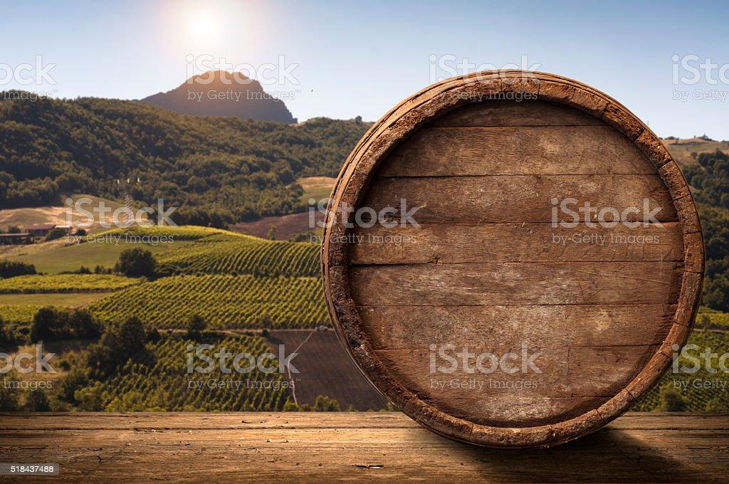corkscrew and wooden barrel, vineyard on background stock photo