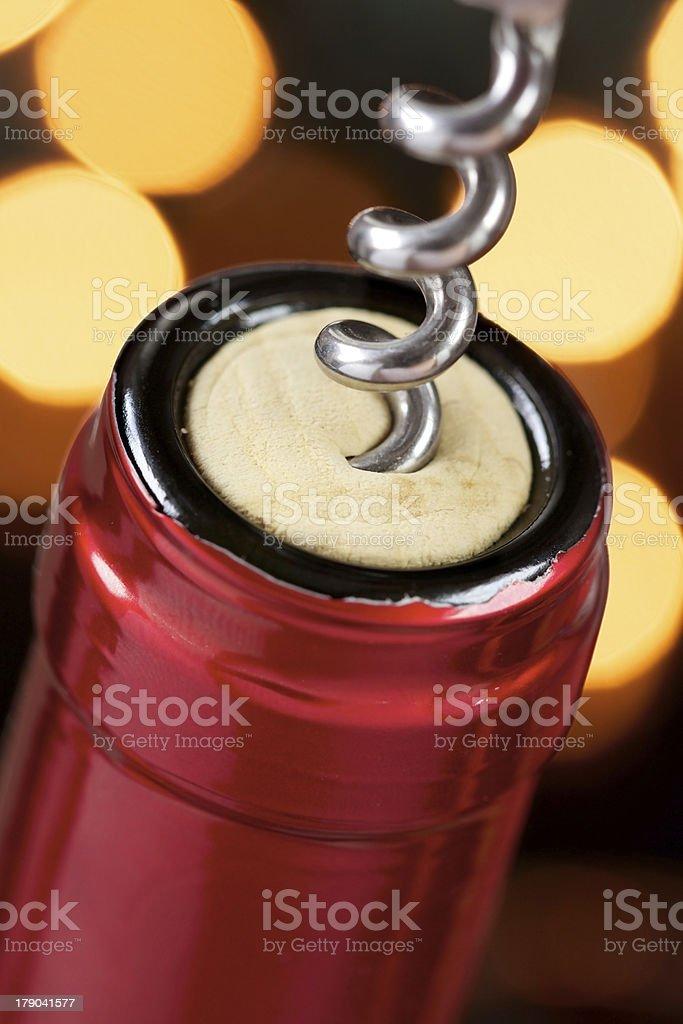 Corkscrew in a wine bottle royalty-free stock photo