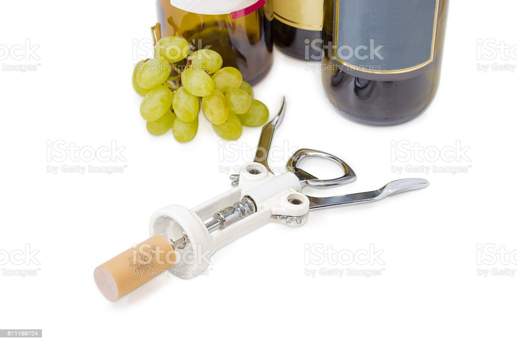 Corkscrew with synthetic wine cork on a light background stock photo