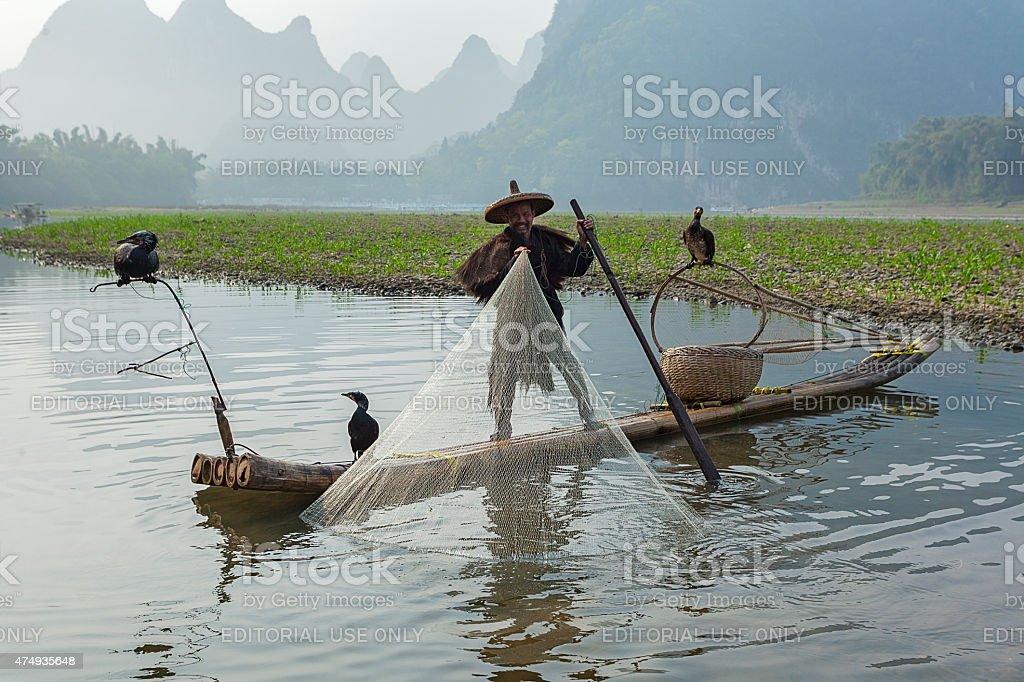 Cormorant, fish man and Li River scenery sight stock photo