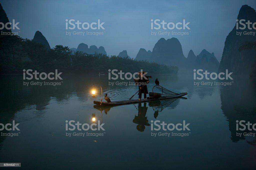 Cormorant fisherman of river Lee stock photo