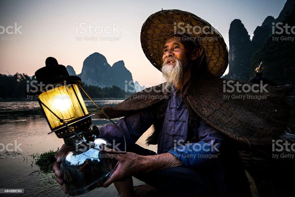 cormorant fisherman portrait stock photo