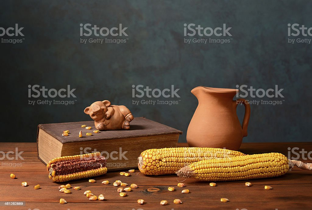 Corn and pigs figures on books royalty-free stock photo