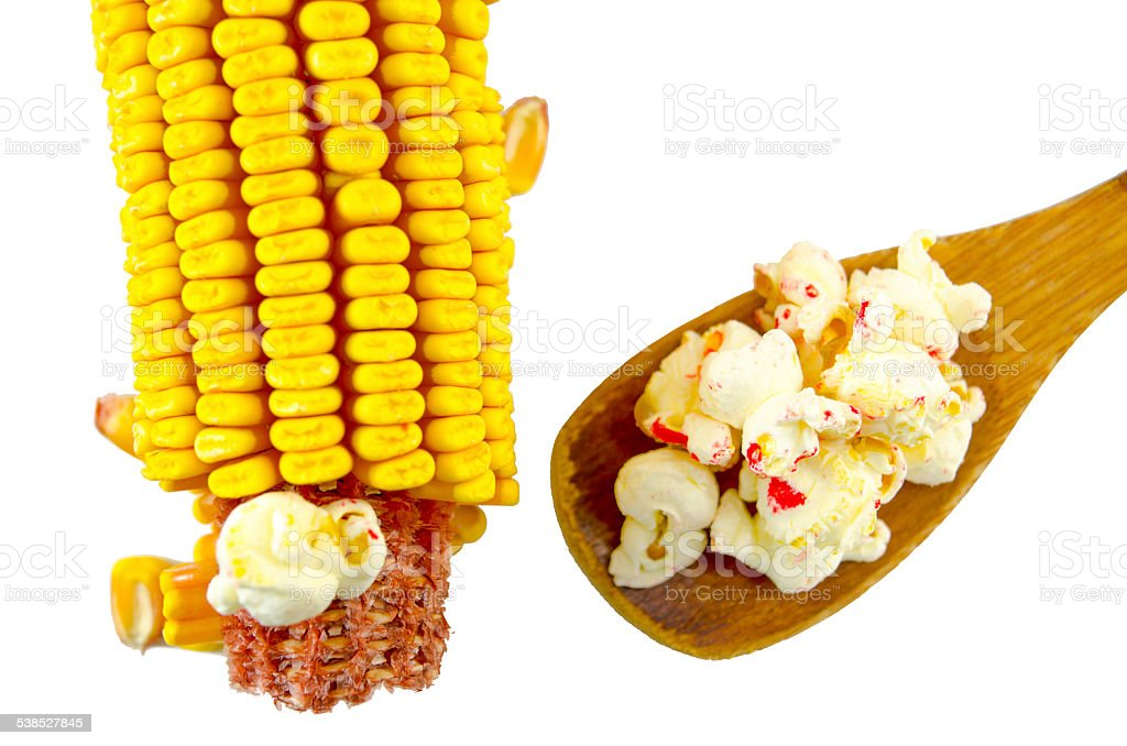 Corn and spoon of popcorns isolated royalty-free stock photo
