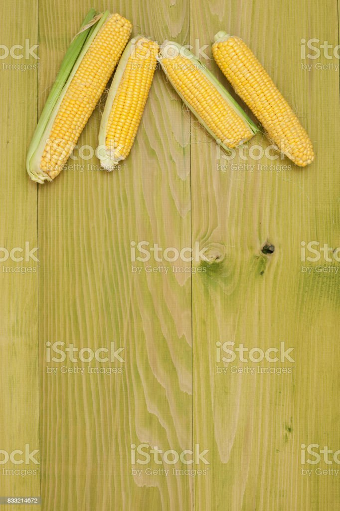 Corn at wooden background stock photo
