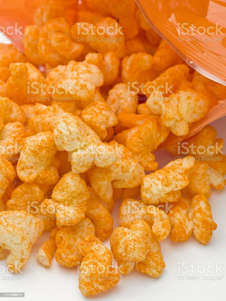 Corn Cheese puffs coming out of the bag stock photo