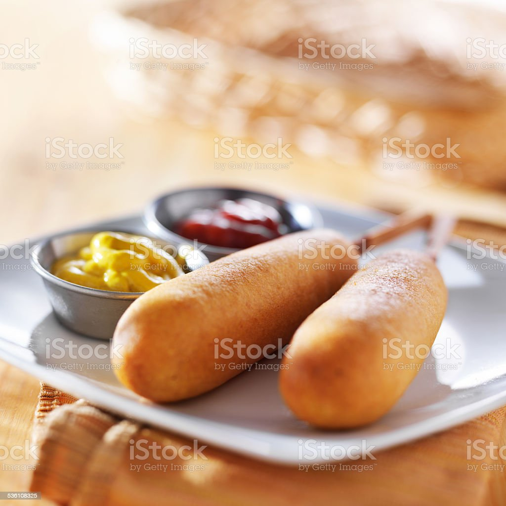 corn dogs with ketchup and mustard stock photo