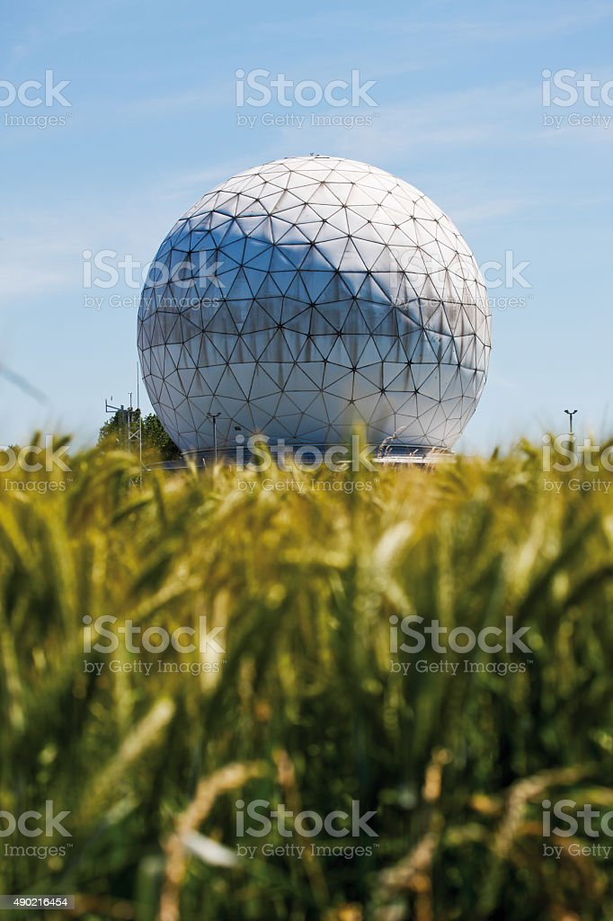Corn field with radome in background. stock photo