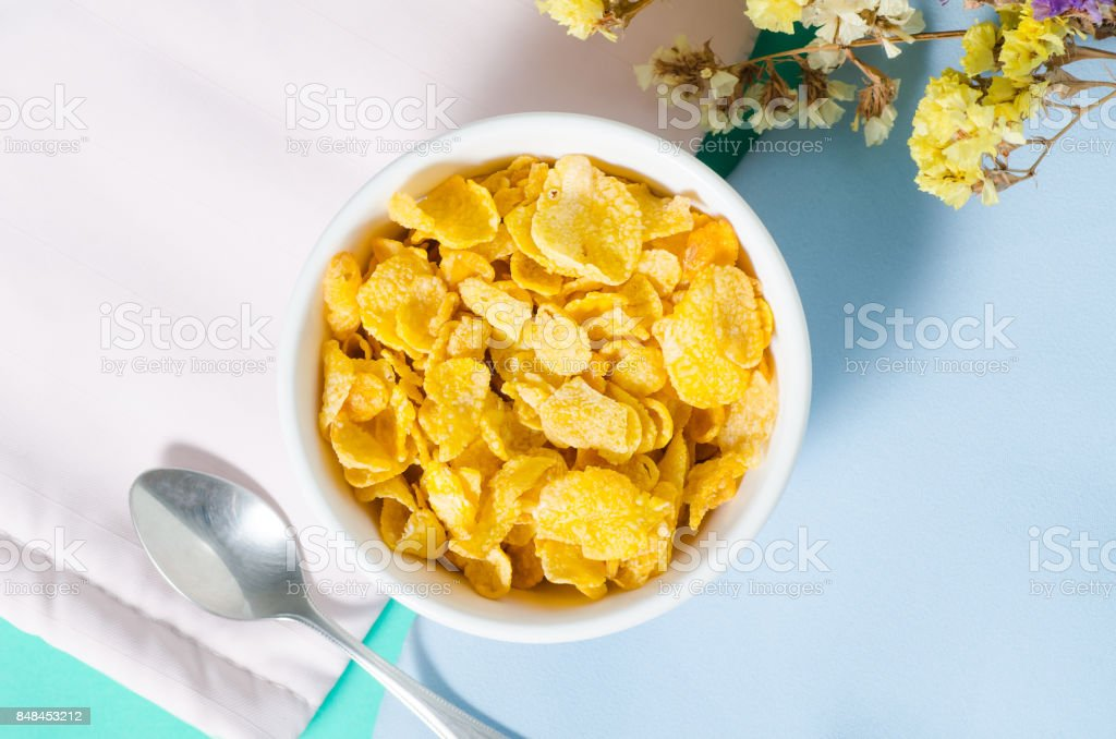 Corn flakes in a bowl with spoon for eating stock photo