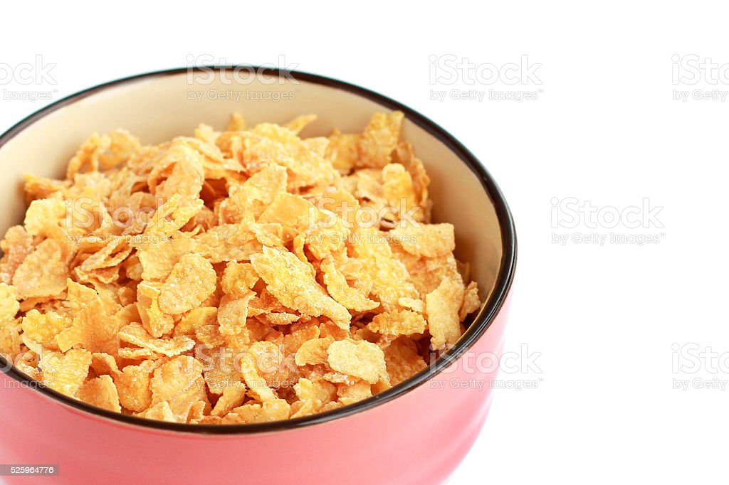 Corn flakes in bowl closeup stock photo